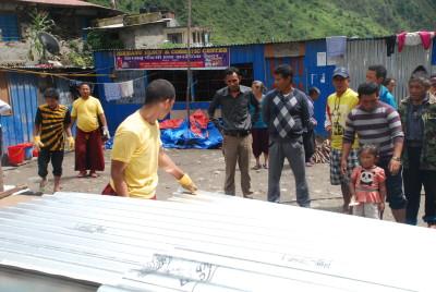 Village supervisors look on